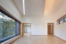 غرفة المعيشة تنفيذ JOHO Architecture
