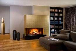 Eckscheibe: moderne Wohnzimmer von Chiemsee Öfen
