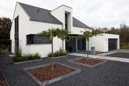 Casas de estilo minimalista por Architektur Jansen