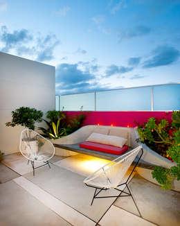 Casa Santiago 49: Jardines de estilo moderno por Taller Estilo Arquitectura