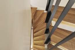 Corridor & hallway by Beat Nievergelt GmbH Architekt