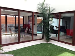 casa 240: Jardines de estilo moderno por Hussein Garzon arquitectura