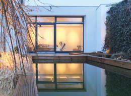 Projekty, nowoczesne Domy zaprojektowane przez qbus architektur  & innenarchitektur