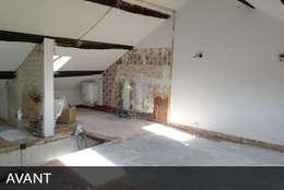 Rénovation d'un appartement:  de style  par AD2