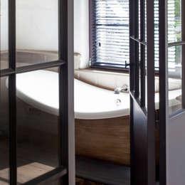Baños de estilo rural por Taps&Baths
