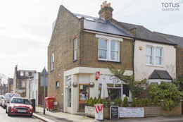 Loft conversion and house remodelling in Wimbledon: classic Houses by TOTUS