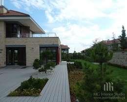 Dom: styl nowoczesne, w kategorii Domy zaprojektowany przez MG Interior Studio Michał Głuszak