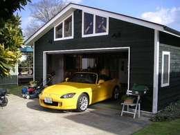 Garajes y galpones de estilo rural por J-STYLE GARAGE Co.,Ltd.