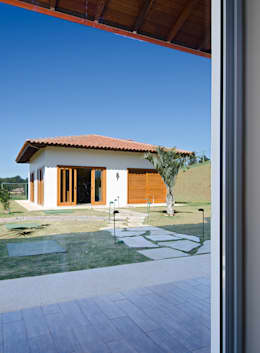 Casas de estilo rústico por NOMA ESTUDIO