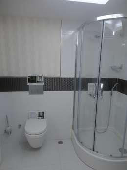 Vizyon mimarlık ve Dekorasyon – D.İNŞAAT / ÖRNEK DAİRE: modern tarz Banyo