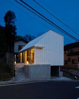Casas de estilo minimalista por 白砂孝洋建築設計事務所