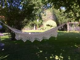 Jardines de estilo rústico por Brasilchic