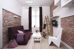 Kawalerka: styl , w kategorii Salon zaprojektowany przez Tarna Design Studio