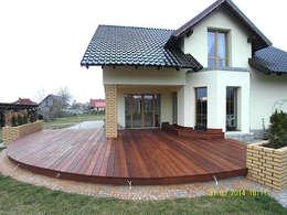 Taras drewniany. Realizacja w Suchej.: styl , w kategorii  zaprojektowany przez PHU Bortnowski