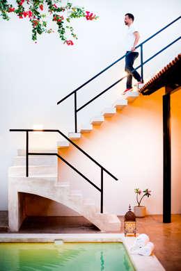 Casa GC55: Pasillos y recibidores de estilo  por Taller Estilo Arquitectura