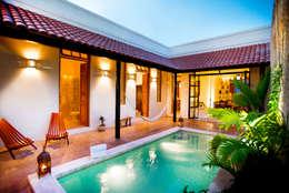 Casas de estilo ecléctico por Taller Estilo Arquitectura