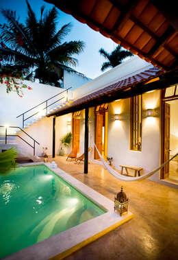 Pasillos y vestíbulos de estilo  por Taller Estilo Arquitectura