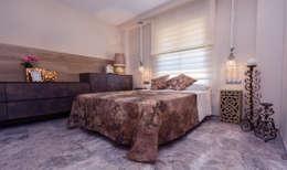 Dormitorio en suite: Dormitorios de estilo mediterráneo de Apersonal