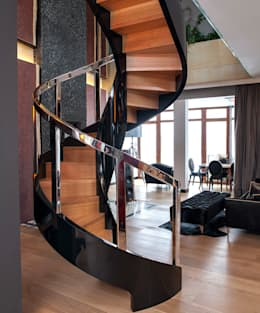 ST780 Schody nowoczesne gięte / ST780 Modern Curved Stairs: styl , w kategorii Korytarz, przedpokój zaprojektowany przez Trąbczyński