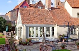 Extension exterior: classic Conservatory by Westbury Garden Rooms