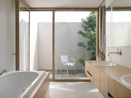 modern Bathroom by Rossetti+Wyss Architekten
