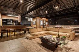 loft casal sala estar e cozinha: Casas industriais por cioli arquitetura e design