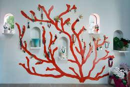 赤珊瑚: 藤本高志建築設計事務所が手掛けた壁です。