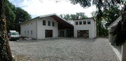 Transformation d'une ferme avicole en logement:  de style  par [GAA] GUENIN Atelier d'Architectures SA