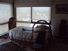 Piso en Retiro: Dormitorios de estilo moderno por GUTMAN+LEHRER ARQUITECTAS