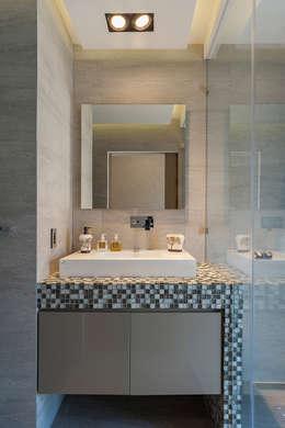 DEPARTAMENTO EN BOSQUE REAL: Baños de estilo  por HO arquitectura de interiores