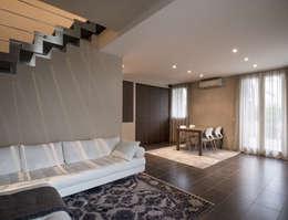 Salas de estilo moderno por Geometrie Arredamenti