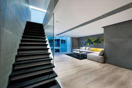 Soggiorno in stile in stile Moderno di Millimeter Interior Design Limited