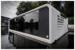 Domy na wodzie : styl nowoczesne, w kategorii Domy zaprojektowany przez floatinghouses