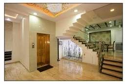 moderne Gang, hal & trappenhuis door sayyam interiors.