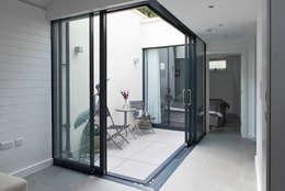 Terraços  por E2 Architecture + Interiors