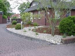 Pflegeleichter Vorgarten : klassischer Garten von Fischer Garten-und Landschaftsbau GmbH