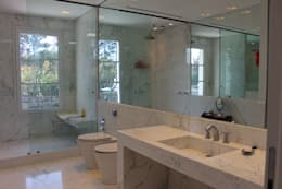INTERIORES: Baños de estilo moderno por JUNOR ARQUITECTOS
