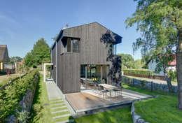 Toiture à deux versants de style  par Möhring Architekten