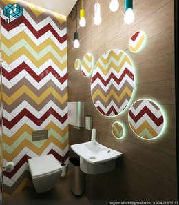 Baños de estilo  por HUGO