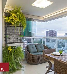 Balconies, verandas & terraces  by Fadel Arquitetura