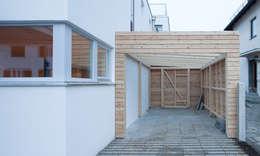 modern Garage/shed by MuG Architekten