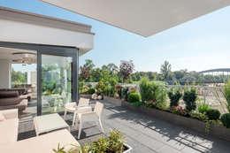 Terrazas de estilo  por arc architekturconzept GmbH