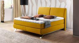 Dormitorios de estilo  por Betten.de