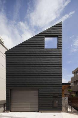 Casas de estilo moderno por U建築設計室