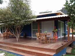 Projekty, rustykalne Domy zaprojektowane przez Cristiane Locatelli Arquitetos & Associados