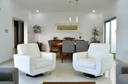 Salas / recibidores de estilo moderno por OBRA BLANCA