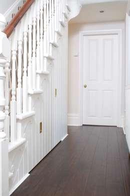 Under Stairs Storage: modern Corridor, hallway & stairs by buss