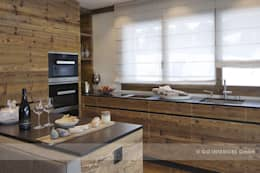 Chalet Valbella: rustikale Küche von Go Interiors GmbH