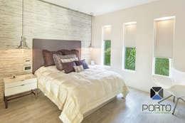 Dormitorios de estilo ecléctico por PORTO Arquitectura + Diseño de Interiores