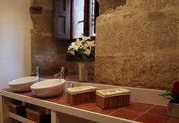 Baños de estilo clásico por Ignacio Quemada Arquitectos
